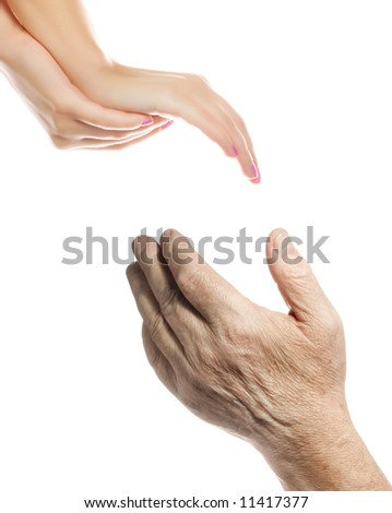 Hands of young woman and elderly man over white background - stock photo