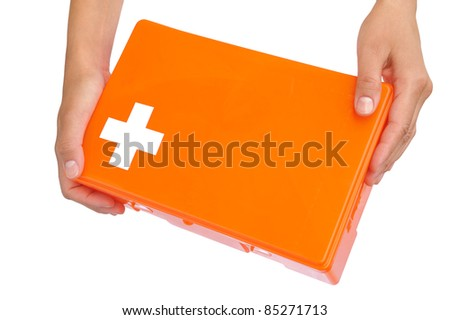 Hands of young woman holding first aid kit - isolated on white - stock photo