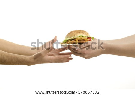 Hands offering a big hamburger and hungry hands ready to receive,isolated on white - stock photo