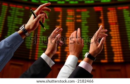hands on a stock market - stock photo