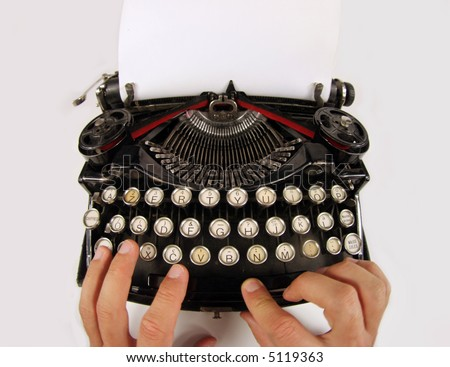 hands on an old typewriter - stock photo
