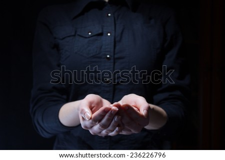 Hands on black background - stock photo