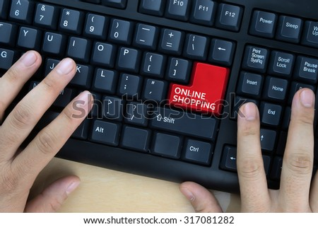 "Hands on computer keyboard with ""Online Shopping"" words at enter button. - stock photo"