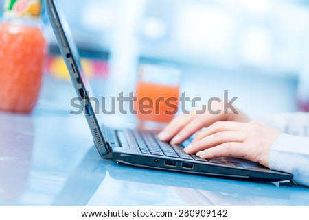 hands on keyboard morning and morning juice - stock photo