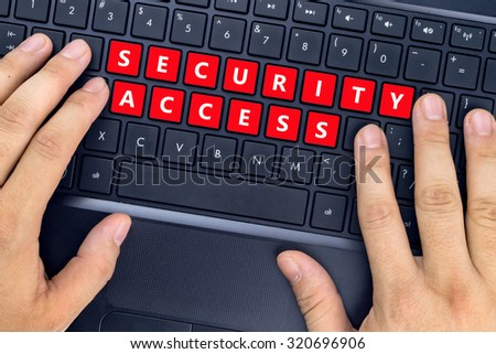 """Hands on laptop with """"SECURITY ACCESS"""" words on keyboard buttons. - stock photo"""