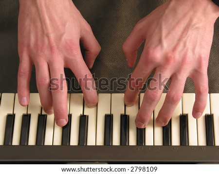 hands on piano - stock photo