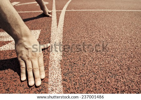 Hands on starting line  - stock photo