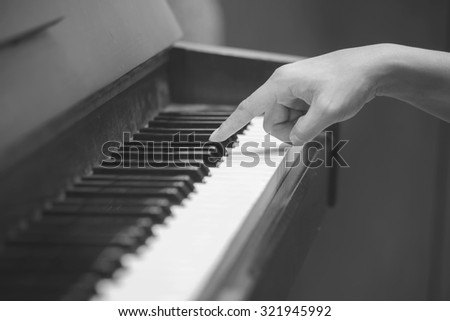 hands on the key of the piano,back and white image - stock photo