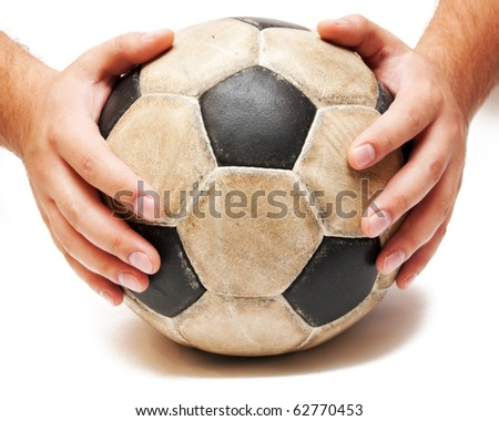 hands on the soccer ball on white - stock photo