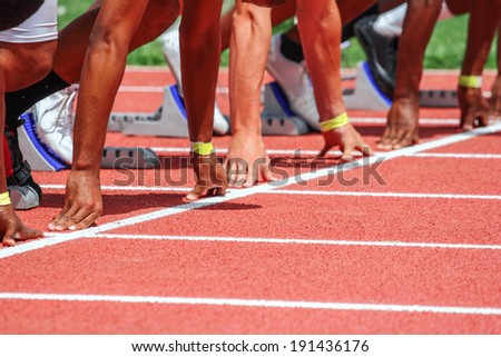 Hands on the starting line - stock photo