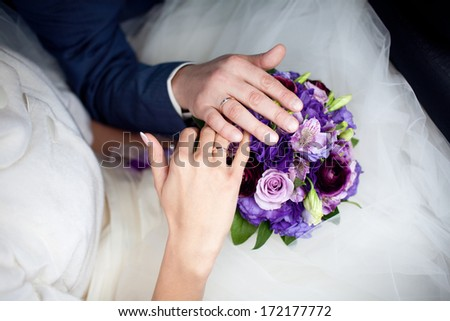hands on the wedding bouquet - stock photo
