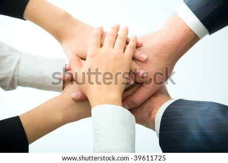 Hands on top of each other. - stock photo