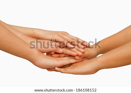 Hands on top of each other showing  unity with their hands together ,concept successful business people - stock photo