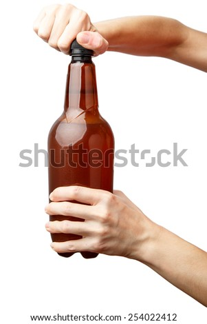 Hands opening a bottle on white background. Brown cold beer bottle Alpha. - stock photo