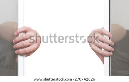 Hands opening window wire net, moving apart, isolated - stock photo