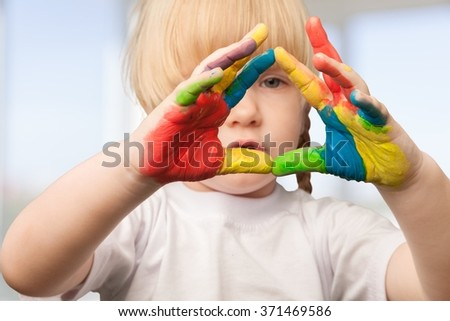 Hands painted in colorful paints. - stock photo