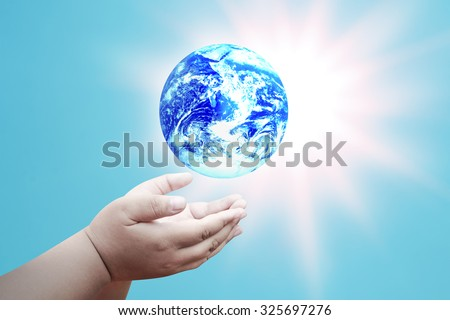 Hands palm up take care of blue global earth over blur sun blasting background Think Earth concept for poster advertising magazine or design Elements of this image furnished by NASA - stock photo