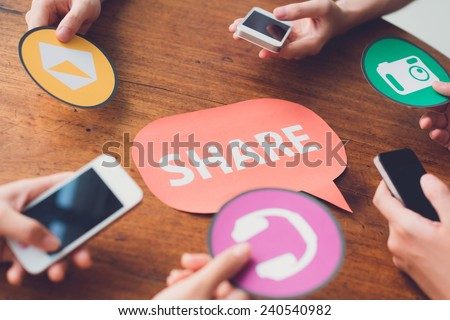 Hands passing application icons: people sharing messages, music, and photos - stock photo