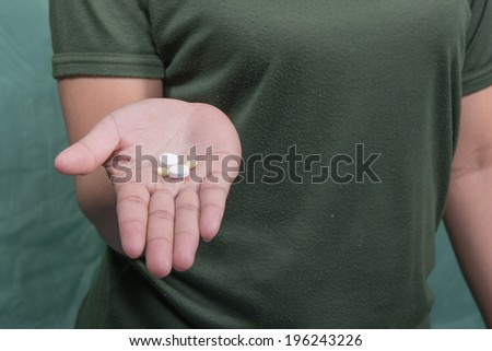 Hands patients medication. - stock photo