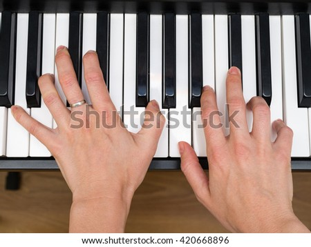 hands, piano keys, top view