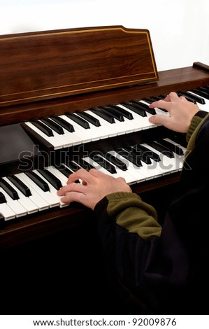 hands playing musical keyboard instrument of electronic organ . - stock photo