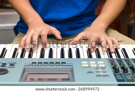 hands playing the keyboard or piano - stock photo