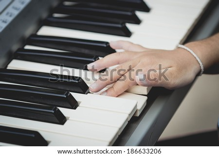 Hands playing the piano (close-up) ,child playing piano