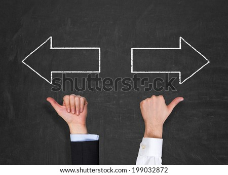 Hands pointing out 'left or right' way and arrows  - stock photo