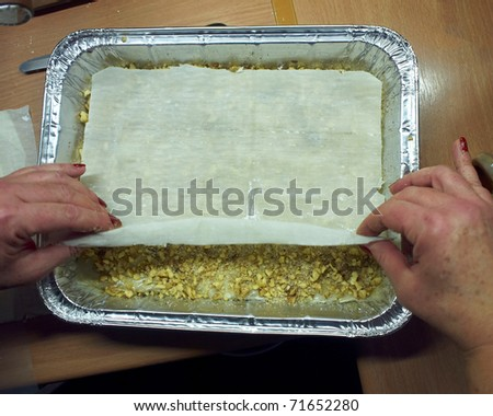 hands preparing home made baklava, traditional middle east sweet - stock photo