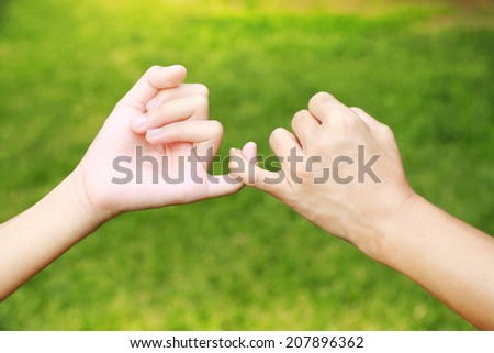 hands promises together of Mom and her daughter - stock photo
