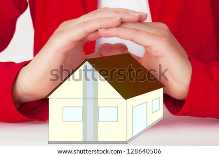 Hands protect home - stock photo
