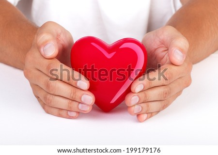 Hands protecting heart. Health insurance or love concept