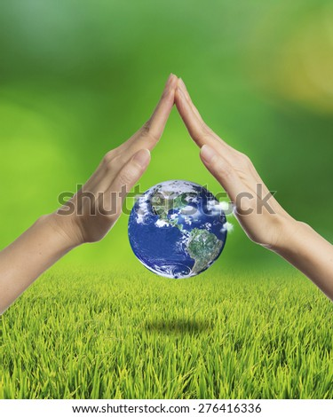 Hands protecting the planet earth, Elements of this image furnished by NASA - stock photo