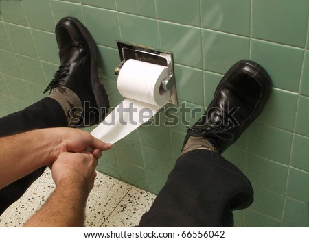 Hands pulling toilet paper. - stock photo