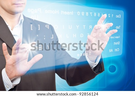 Hands pushing a button on a touch screen. Virtual Keyboard