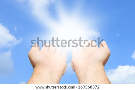Hands reaching for the sky - stock photo