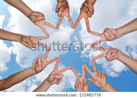 Hands showing star under the sky forming a social network - stock photo