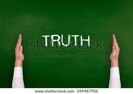 Hands Showing TRUTH on Blackboard - stock photo