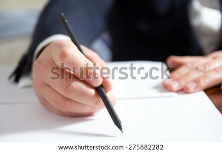 Hands signing business documents.Signing papers. Lawyer, realtor, businessman sign documents. - stock photo
