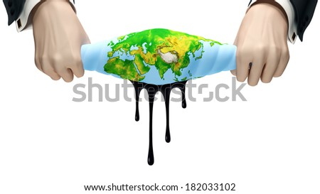 Hands squeeze out globe from which oil exudes - stock photo