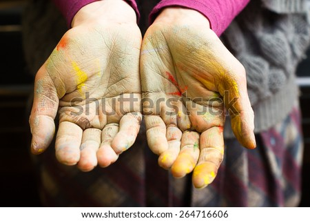 Hands stained with clay and paint. Hands painter and sculptor. Children's creativity and a hobby for adults. Modeling. Hands and fingers stained with paint. - stock photo