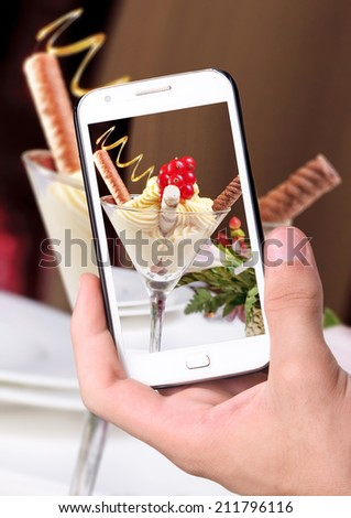 Hands taking photo ice cream  with smartphone - stock photo