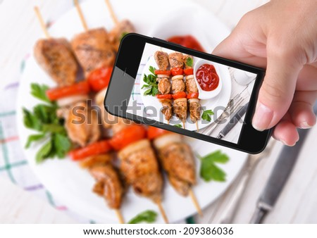 Hands taking photo  kebab with smartphone - stock photo