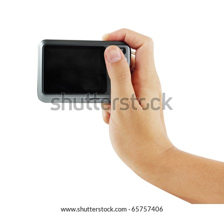 hands taking picture with a compact digital camera