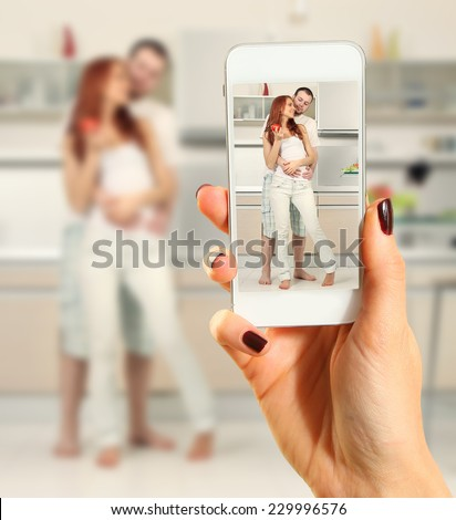 Hands talking photo of beautiful couple with smartphone - stock photo