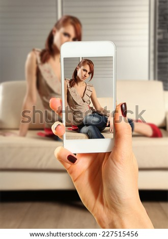 Hands talking photo of beautiful woman with smartphone - stock photo