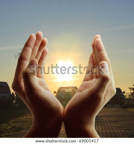 Hands the evening sun - stock photo