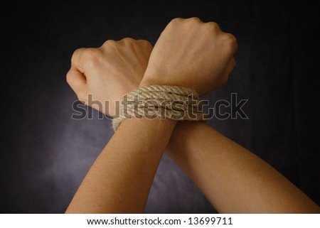 hands tied - stock photo