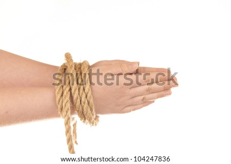 Hands tied with natural hemp isolated on white background
