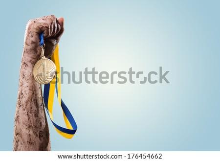 Hands tighten medal  - stock photo